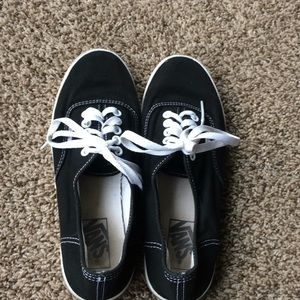 Black and white pair of vans